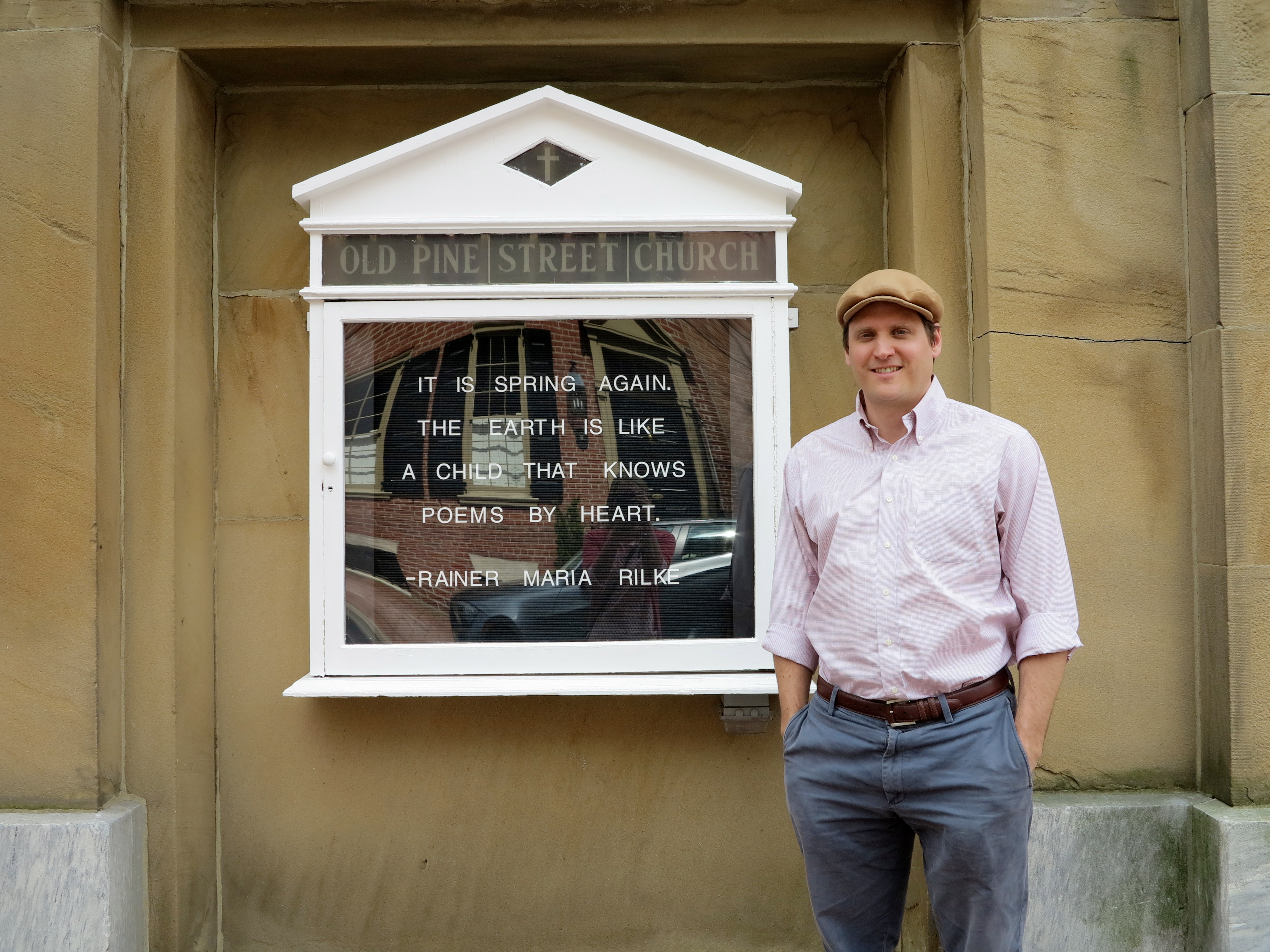 Rev. Jason Ferris and the Old Pine Street Church signboard