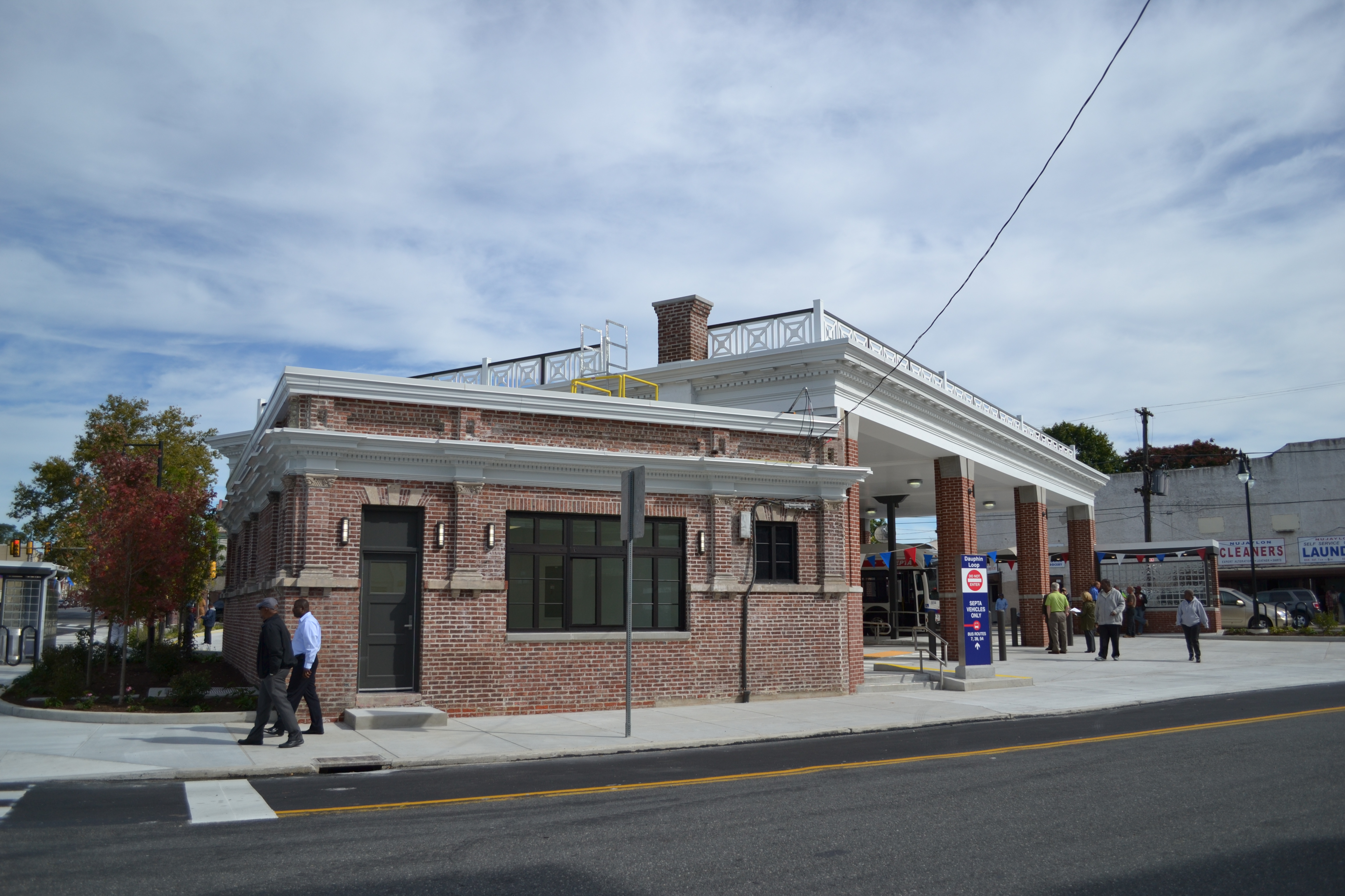 SEPTA preserved and restored the bus loop building, left, and replaced the bus canopy, right, using some of the original bricks