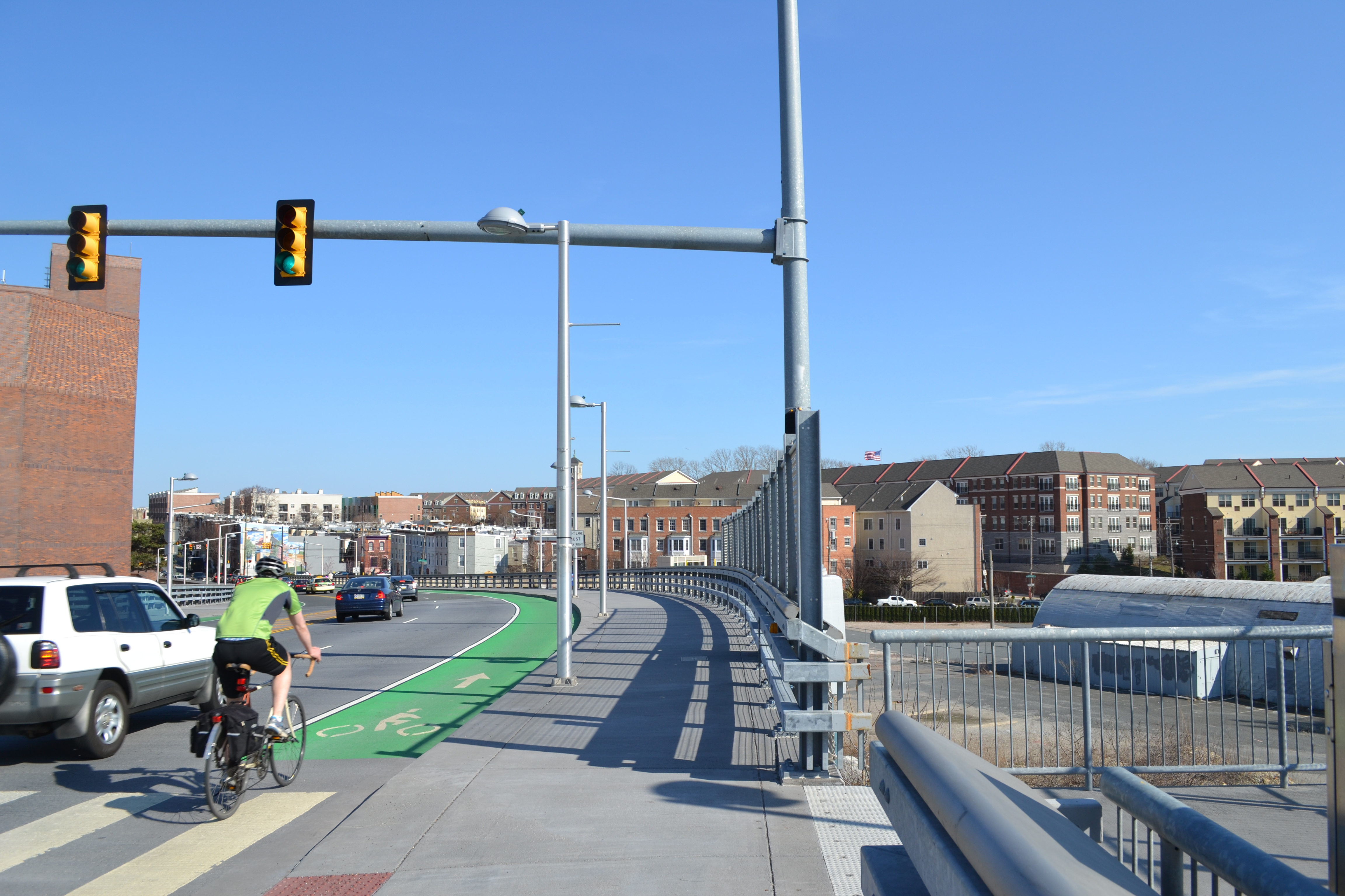 The Bicycle Coalition of Greater Philadelphia wants to shift the bike lanes closer to the top of the bridge to reduce conflicts with the proposed driveways
