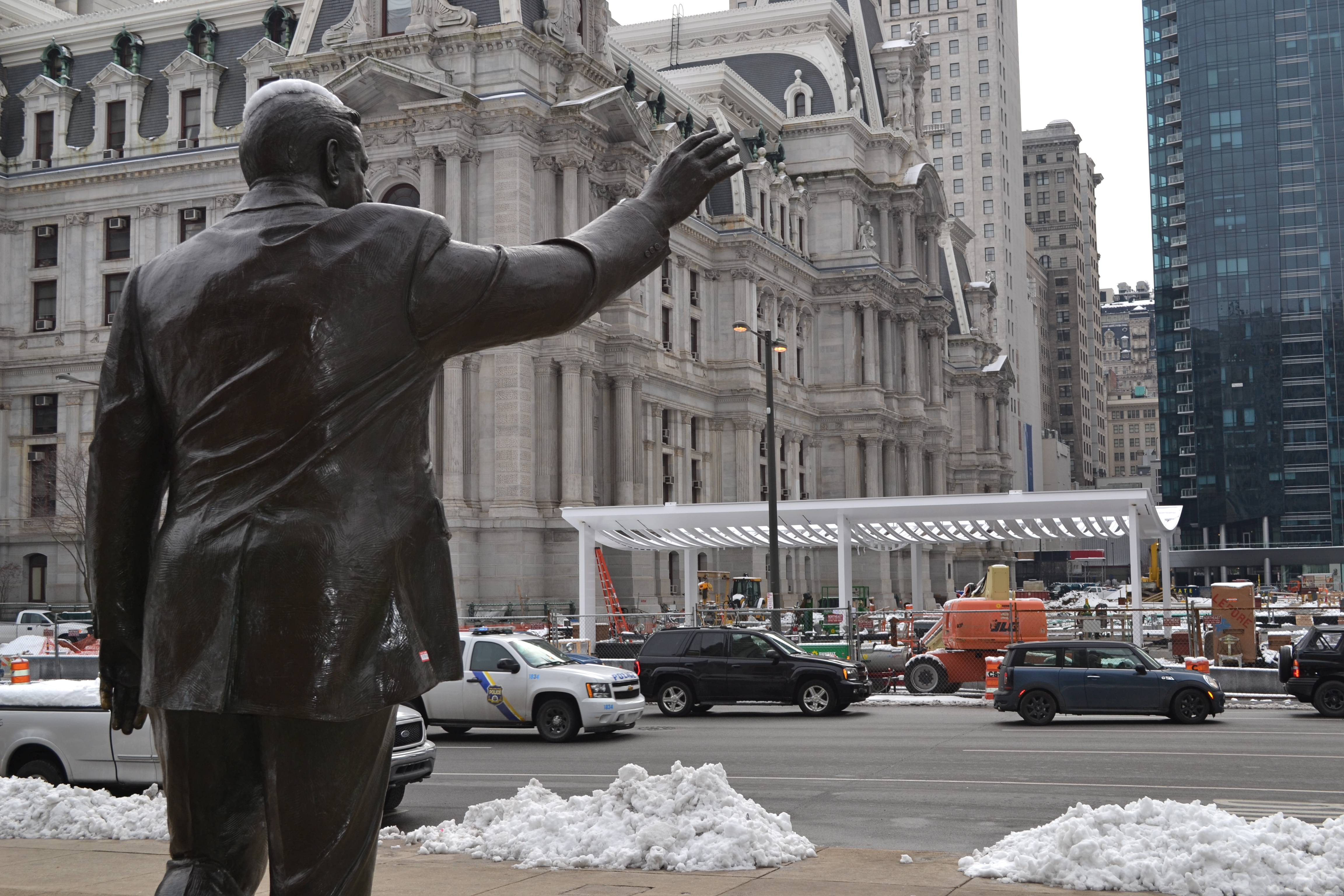 The cafe structure sits directly across from the Municipal Services Building and the Frank Rizzo statue