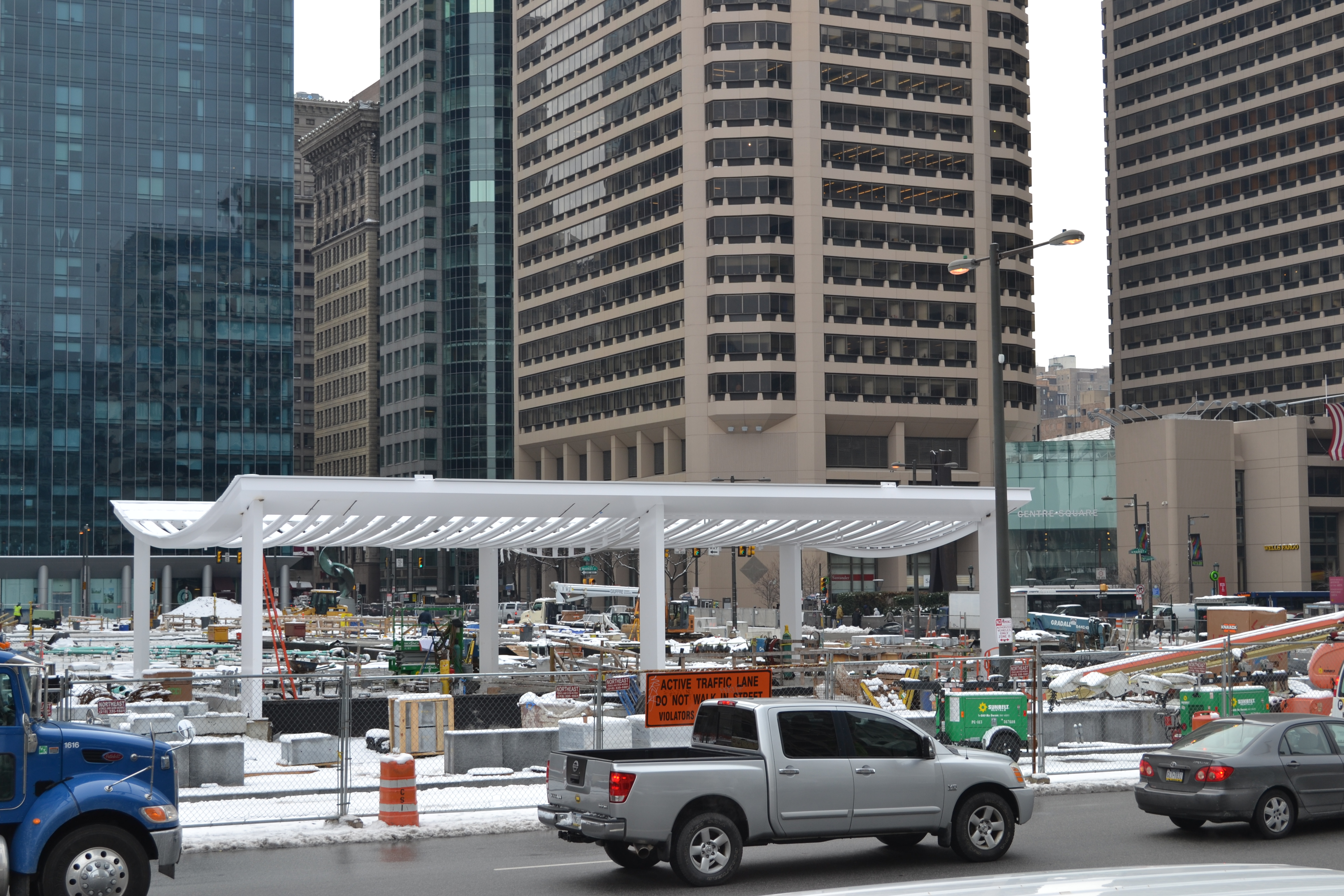 The new structure at the north end of Dilworth Plaza will house a cafe, entrances to the transit network below and an information booth