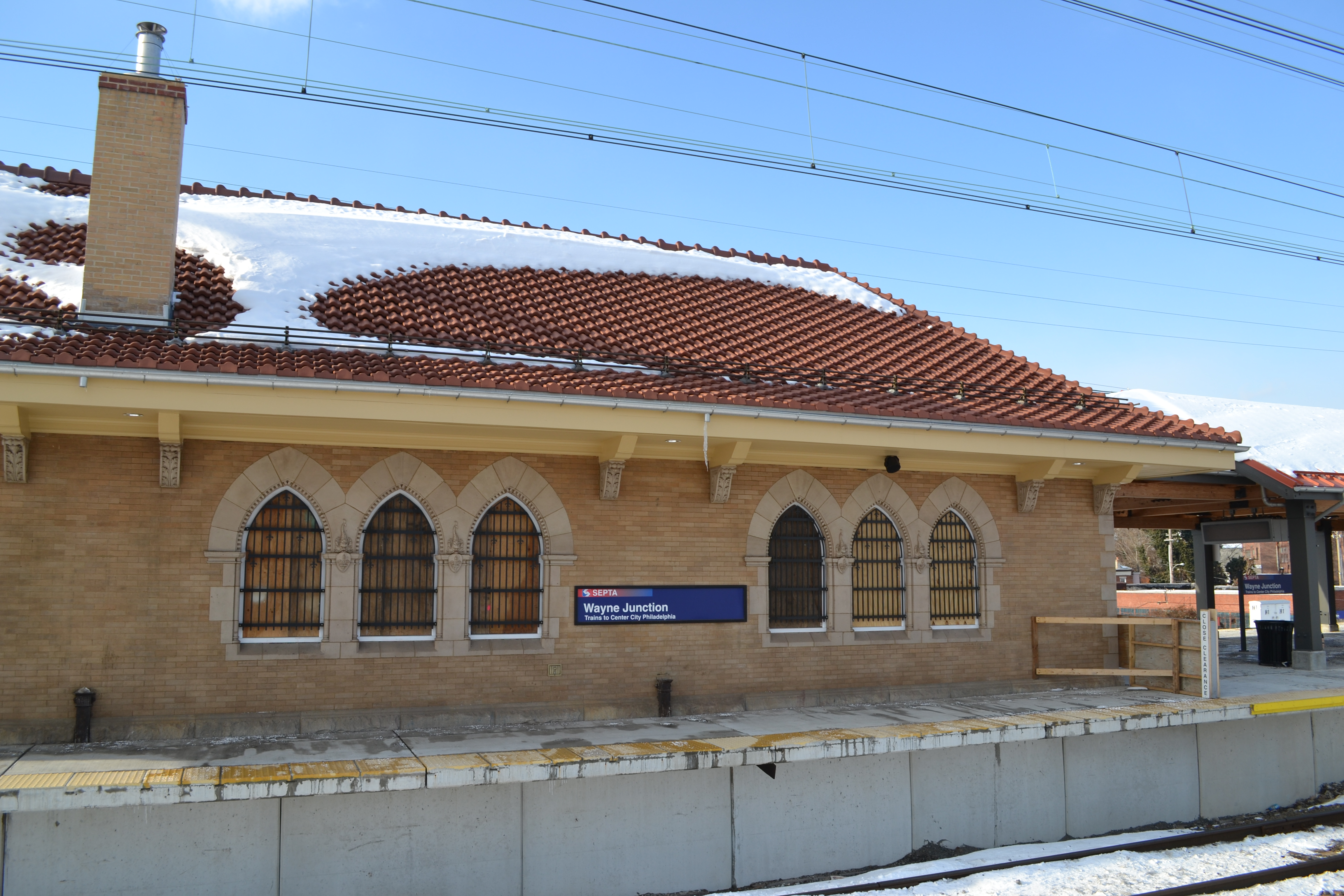 The station building is still under construction, but the roof work is complete