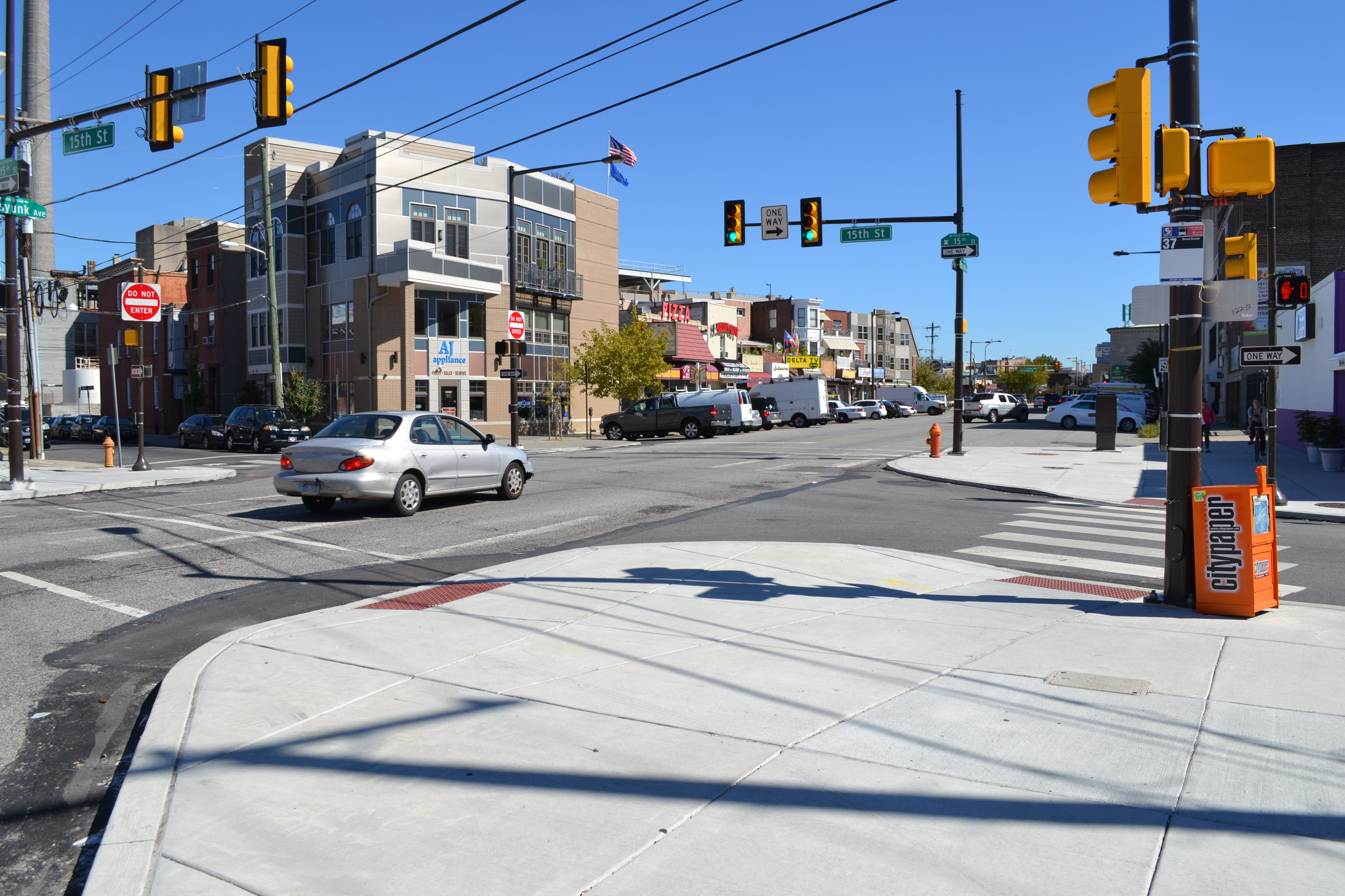 The Streets Department installed curb bump-outs, curb extensions into the roadway, to reduce pedestrian crossing time and improve signal timing