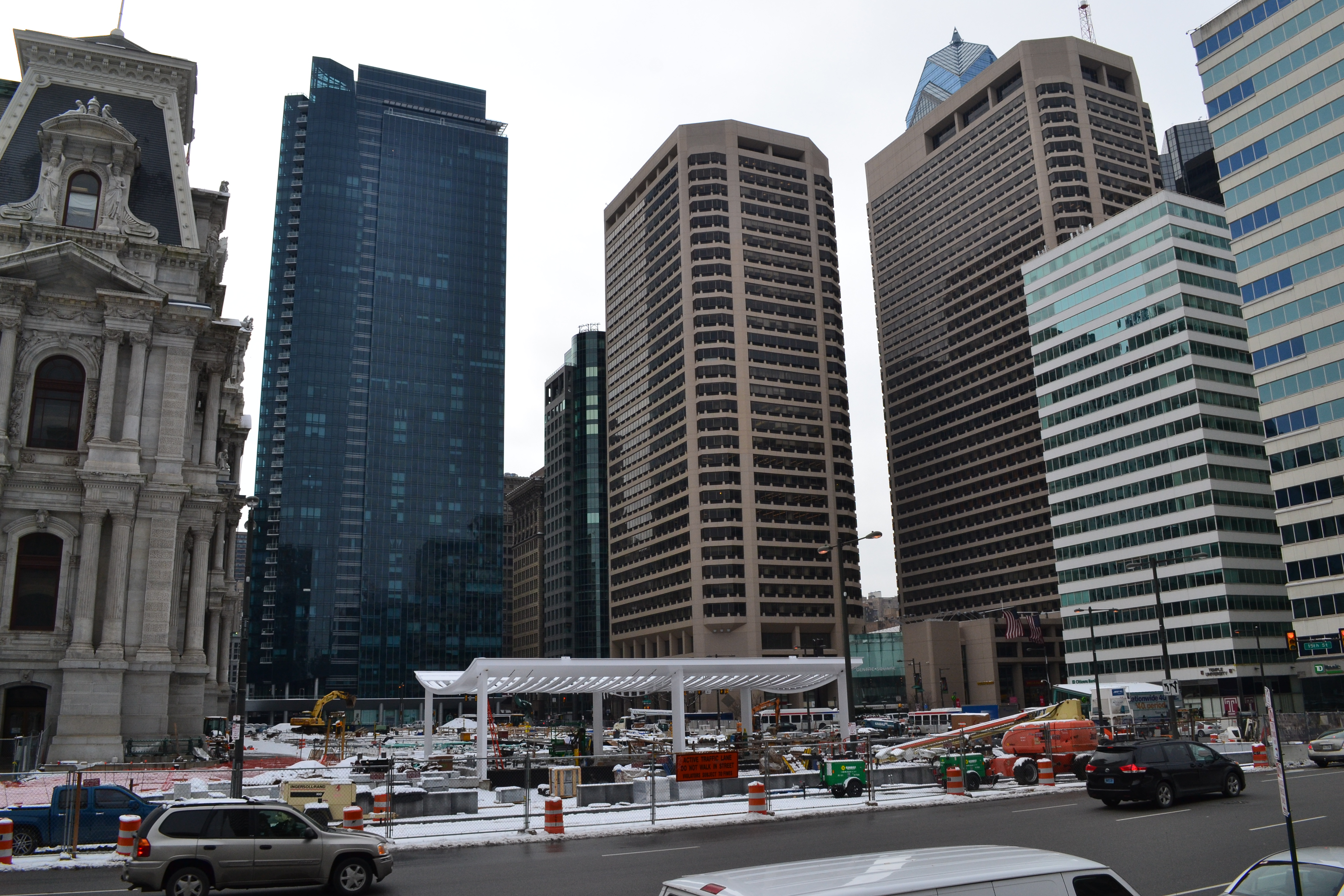 The structure is dwarfed by the surrounding skyscrapers