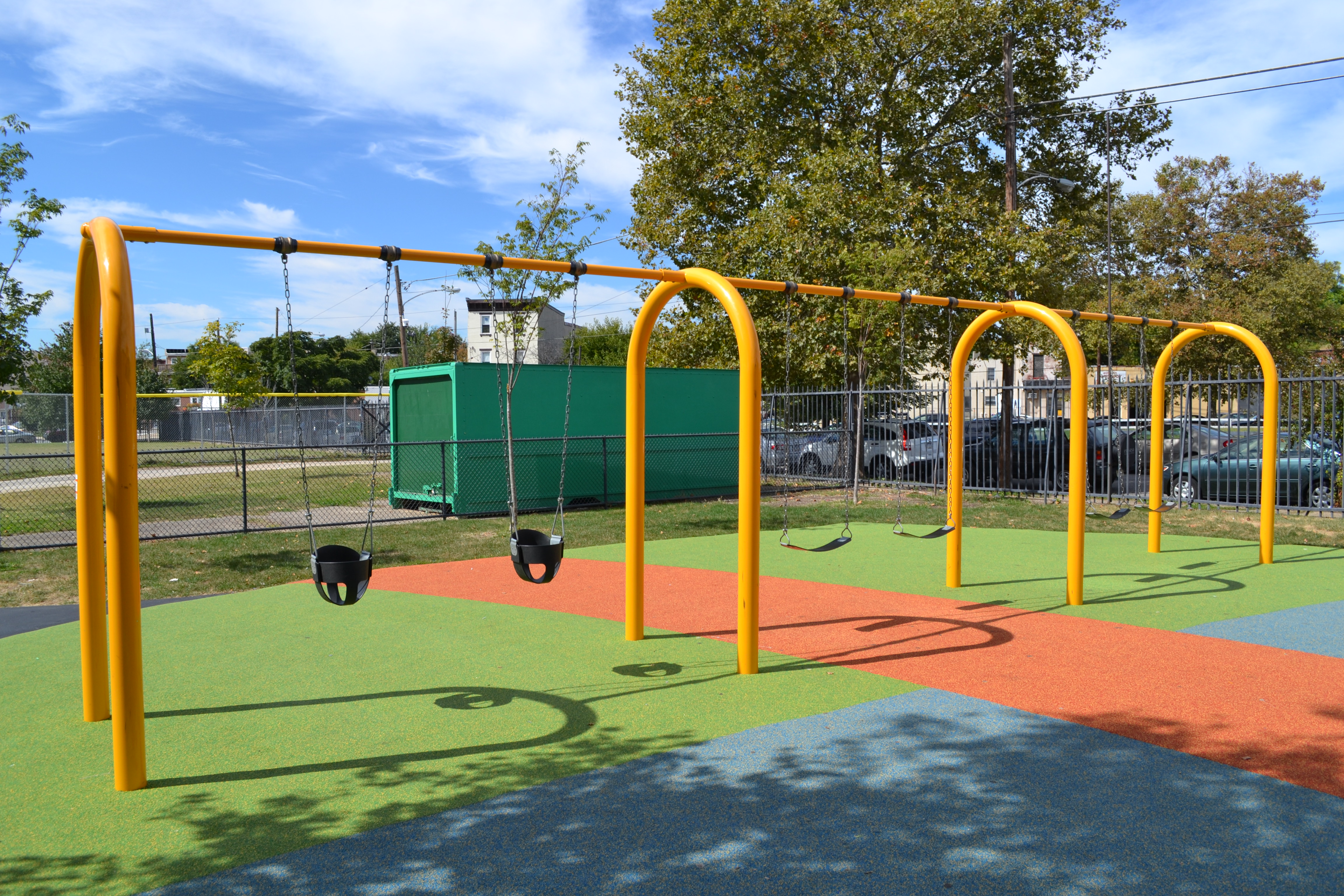The swings and colorful, bouncy play surface at the upgraded Francisville Playground