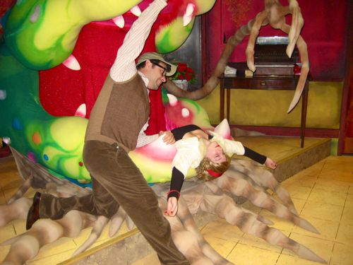 Seymour (Michael Indeglio), the hapless hero of LITTLE SHOP OF HORRORS, attempts to rescue his love Audrey (Jordi Wallen) from a man-eating plant in The Devon Theater's production of the cult clas
