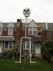 A 20-ft skeleton watches over the 3300-block of Tudor St. in Mayfair. Submitted by his owner, Donny.