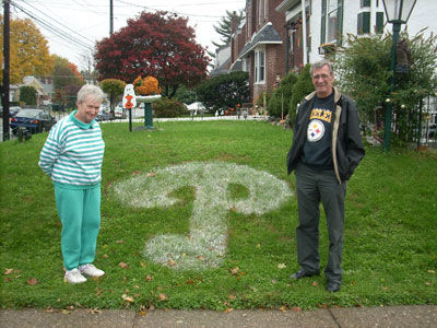 Jack and Betty Vogler are amused by the graffiti on their lawn. Photo courtesy of KYW.