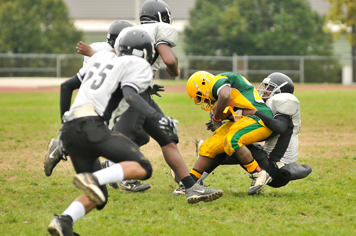 Blanketed by four Fels defensemen, it was Fels' Desmond Strickland (30) who wrapped up Edison's Tyree Kirkland (23) for a loss of yards.