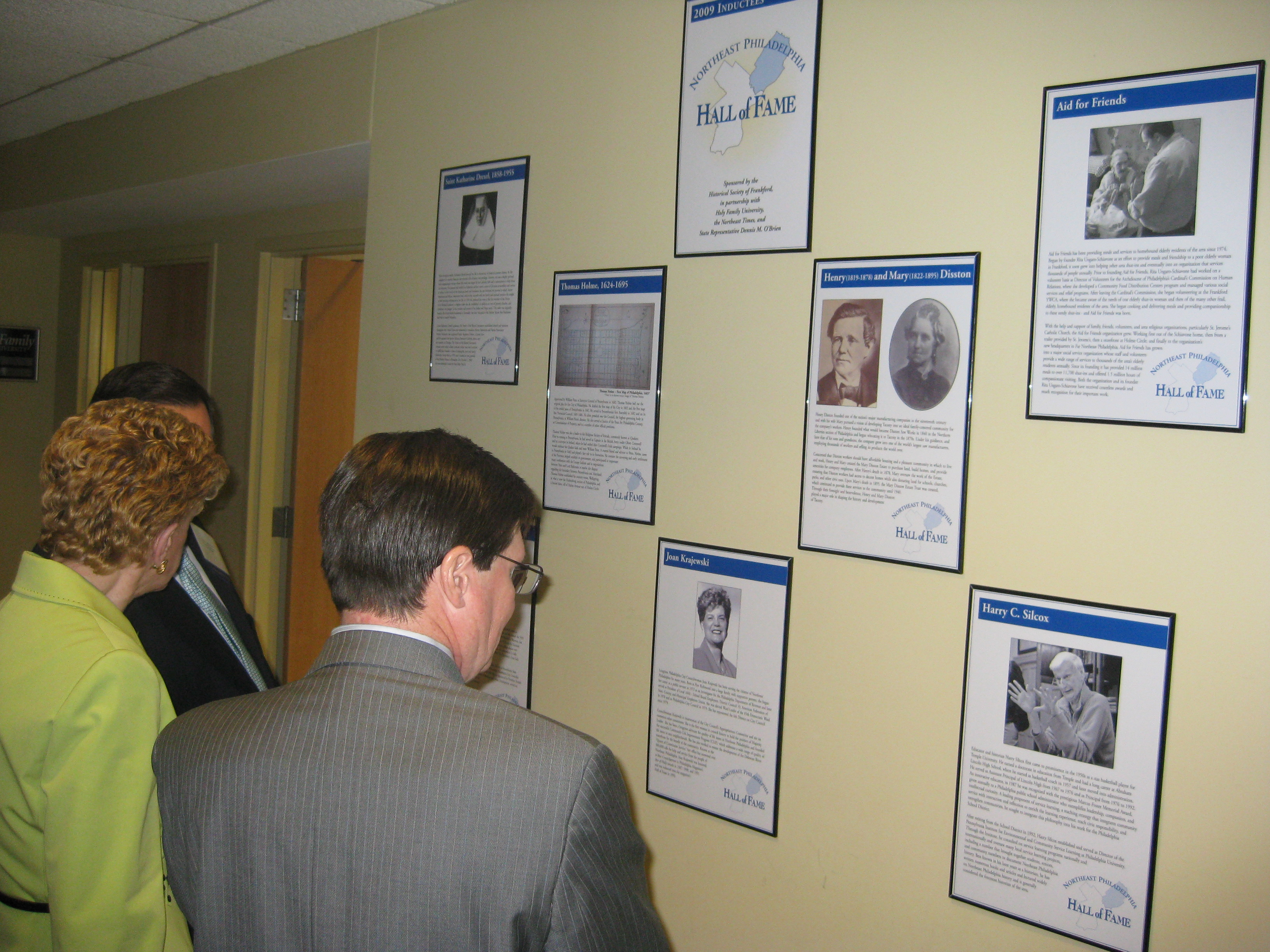 City Councilwoman Joan Krajewski (l) examines the wall of inductees to the Northeast Philadelphia Hall of Fame. Photo by Christopher Wink.