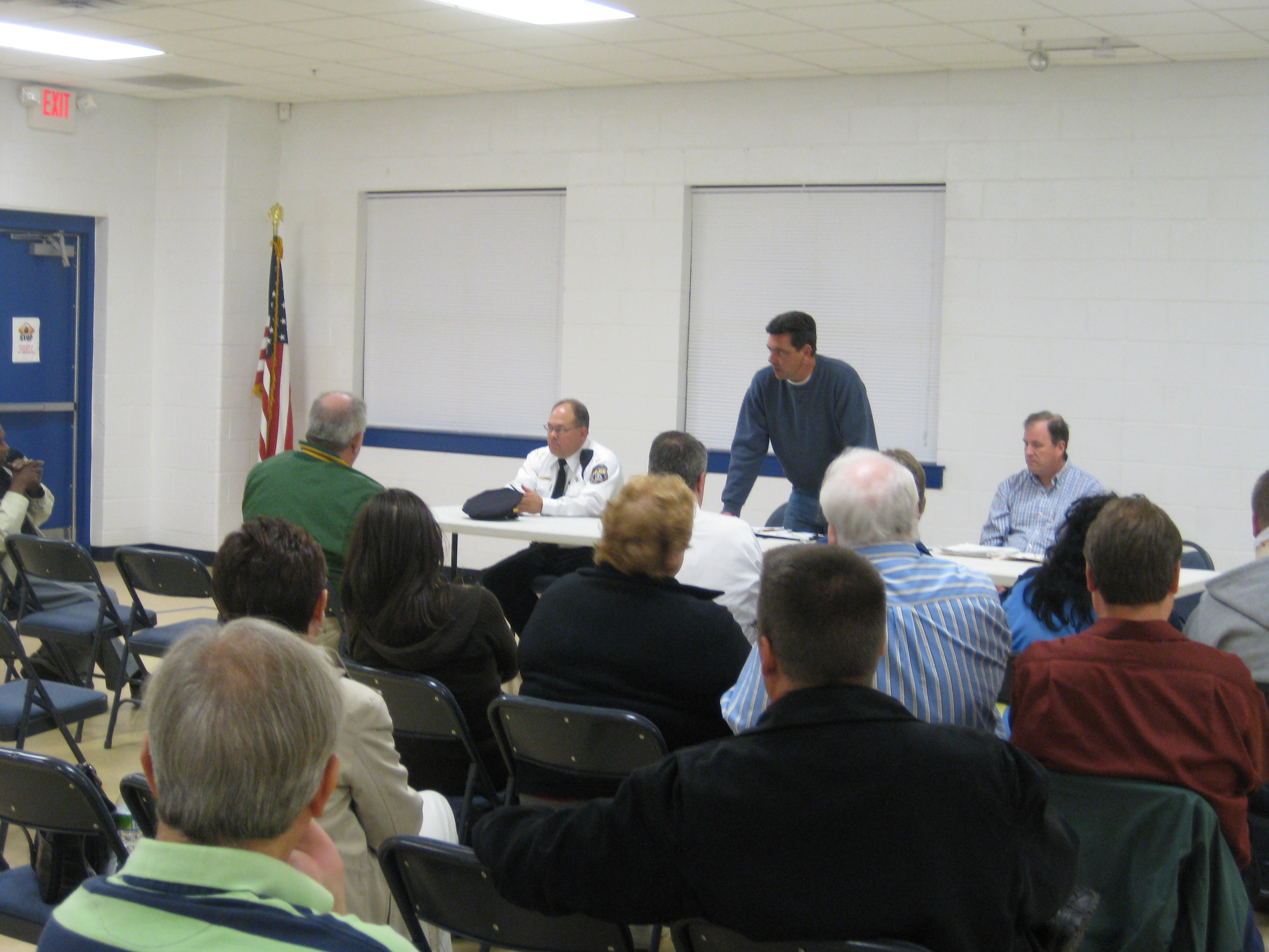Mayfair Town Watch president John Vearling (center) takes suggestions from members of the newly formed group.