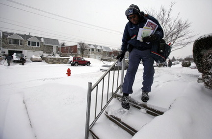 Despite the nearly two feet of snow, mail carriers trudged on. AP photo taken in the Northeast.