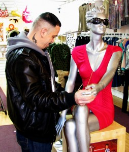 Store manager June Zaye feigns a dance with a mannequin in Dream Girl's Fashion on Frankford Avenue.