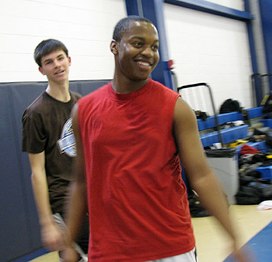 John McCarthy (left, background), 17, and Terrence Bond (foreground), 16, take a break from shooting hoops after school at the Perzel Center. McCarthy is a student at North Catholic High School, and B