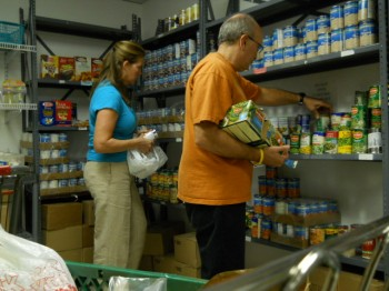 Norman and Colleen Millan help to fill the pantry at the Klein JCC in Northeast Philadelphia. Photo by Tom Rowan Jr.