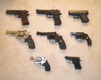 Mike's guns -- Top left to right: Colt Commander Series 80 .45 ACP, Berretta FS-92 9mm pistol, Glock 26 9mm pistol. Middle left to right: Smith & Wesson Model 629 .44 Magnum revolver, Smith & Wes