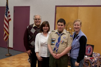 Eagle Scout Andrew Stockette celebrates with (L to R) SPIN founder David Lossino, SPIN community affairs director Bernice McHale and his occupational therapist Beth Konde.