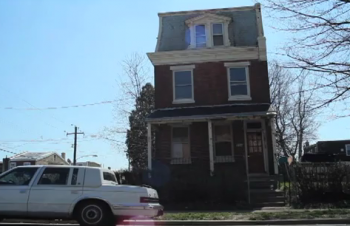 Vacant houses like the one across the street from 6th District Council candidate Sandy Stewart in Tacony prompt concerns about absentee landlords.