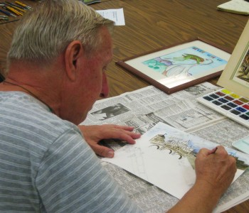 Artist Robert Obodzinsky painting a water color of The Basilica di S. Pietro