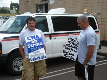 Verizon workers picket what they say is non-union work at the Oxford Avenue Rite Aid in Fox Chase.