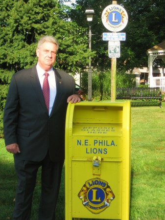 Northeast Lion Rich Wilson at the eyeglass drop off box located in Lions Park, Fox Chase