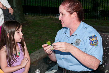 Gianna Rosati and 8th District Officer Trisha Rosati get a moment to talk. Photo/George Mai