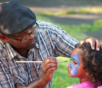 Face-painters drew long lines at the Seven Mile Road Church Community Bash. Photo by George Mai.