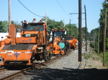 SEPTA crews work on the Fox Chase Line along the 7800-block of Oxford Avenue.