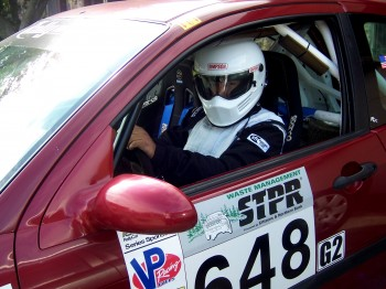 Anthony Concha behind the wheel of the car he uses for rally races. Photo by Pamela Seaton.