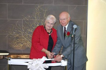 The Rev. James E. Tallman (right) and his wife Pat Tallman (left) cut the ribbon in The Rev. James E. Tallman Meditation Chapel at the Wesley Enhanced Living retirement community. Photo provided by We